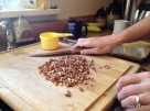 chopping pecans for the salad