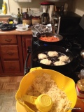 assembly line starting with raw potato mixture for latkes