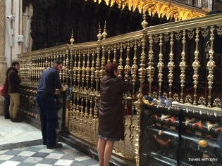 man cleaning brass in the cathedral