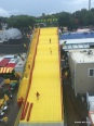 Workers squeegying the giant slide-from skyride