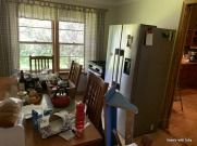 stove and fridge in dining room
